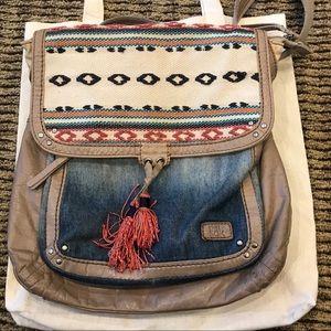 The Sak back pack back converts to messenger bag